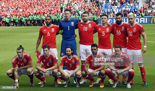 Wales' defender Ashley Williams Wales' goalkeeper Wayne Hennessey Wales' forward Sam Vokes Wales' defender James Chester Wales' midfielder Joe Ledley...