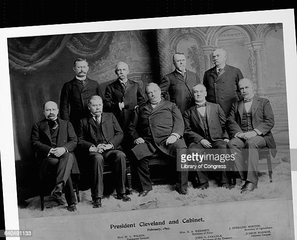Back row left to right are David Francis Secretary of the Interior William L Wilson Postmaster General Hilary A Herbert Secretary of the Navy and...