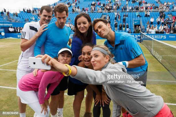 Jamie Murray Andy Murray Laura Robson Ross Hutchins Front row leftright Martina Hingis Heather Watson pose for a selfie taken by Victoria Azarenka at...