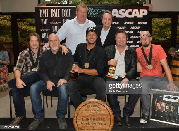 Back row Mike Sistad ASCAP and Jody Williams BMI Front row Josh Kear Producer Jeff Stevens Luke Bryan Rodney Clawson and Chris Tompkins at The BMI...