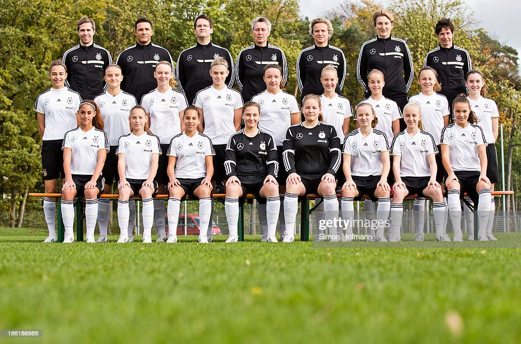 Back row (L-R) Team manager Christopher Hammer, Joerg Vesper, Dr. Andreas Groll, Heike Braune, Birte Knop, assistant coach Carmen Holinka, head coach Bettina Wiegmann; 2nd row (L-R): Linda Liedel, Lisa Schoeppl, Annalena Rieke, Lisa Schueler, Tanja Pawollek, Janina Minge, Giulia Gwinn, Lena Lattwein, Lena Reiter; front row (L-R) Fatma Sakar, Sarai Linder, Noemi Gentile, Kristin Kosel, Dinah Baum, Alisa Pesteritz, Janina Minge and Jule Baecker of Germany pose during the German Girls U15 national team presentation at Wiener Ring training ground on October 29, 2013 in Offenbach, Germany.