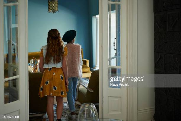 back shot of girls exploring a rental house - house rental stock pictures, royalty-free photos & images