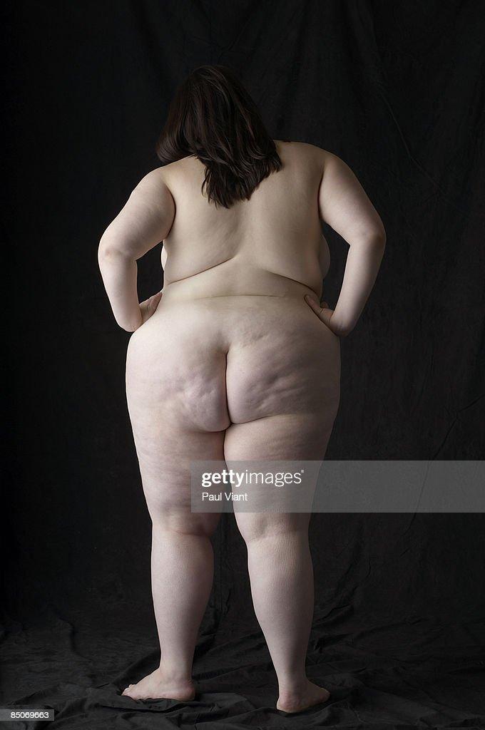back shot of large nude lady : Stock Photo