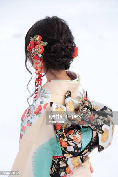 back shot of standing young woman of coming‐of‐age ceremony - seijin no hi stock pictures, royalty-free photos & images
