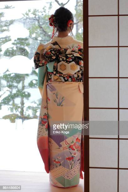 back shot of young woman of coming‐of‐age ceremony - seijin no hi stock pictures, royalty-free photos & images