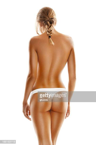 back side view of a young, blonde woman's perfect body. - bare bottom women stock photos and pictures