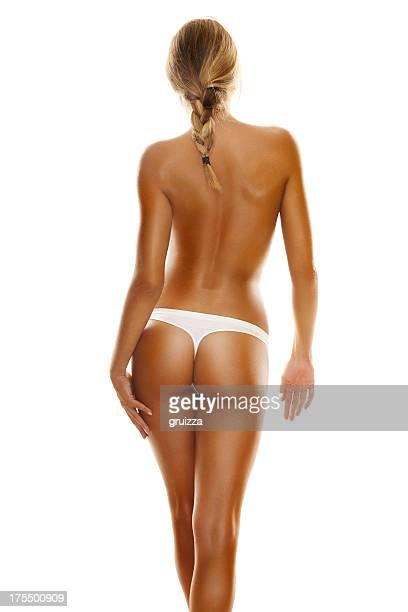 Back vista lateral de un joven, rubia mujer con cuerpo perfecto