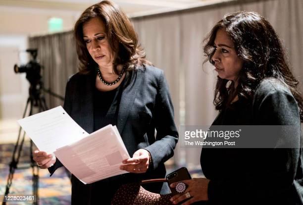 Back stage Democratic Candidate for President Senator Kamala Harris , with sister and advisor Maya Lakshmi Harris, right, prepares to speak to women...
