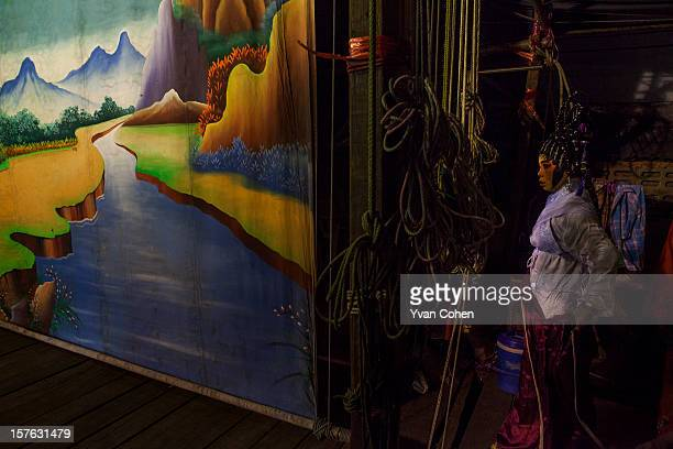 A back stage scene during a Chinese opera performance in Bangkok Chinese opera is performed in Thailand by itinerant groups of players most of whom...