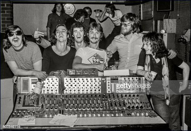 Back Street Crawler pose around the mixing desk ina recording studio, London, 1975. Paul Kossoff is on the right.