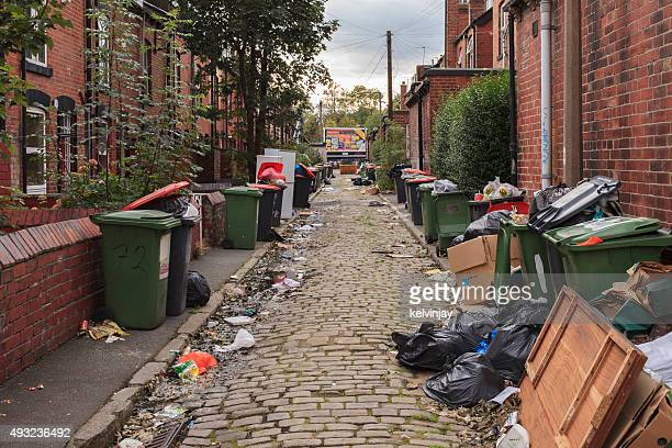 back street full of rubbish and bins in leeds - striker stock pictures, royalty-free photos & images