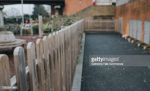 back street - fence stock pictures, royalty-free photos & images