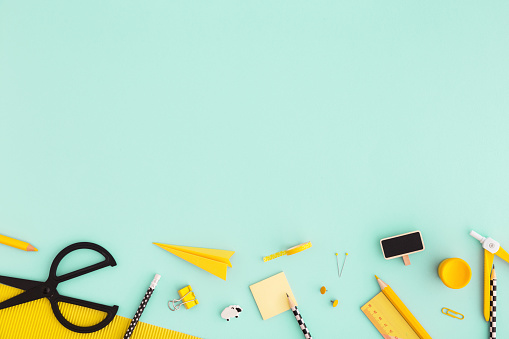 Back to school background with yellow school supplies Flat lay. 939884508