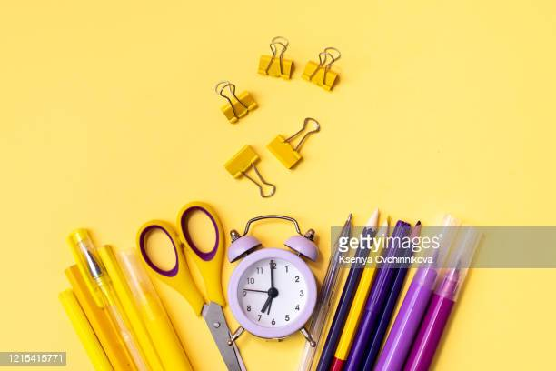 back to school concept on yellow wooden background. top view - the four elements stock pictures, royalty-free photos & images