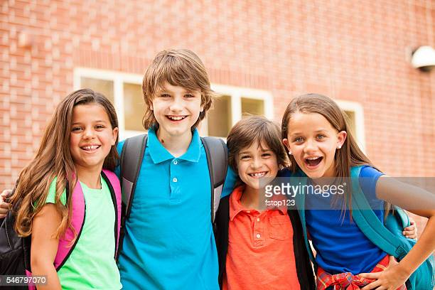 Back to School:  Elementary-age children, friends on school campus.