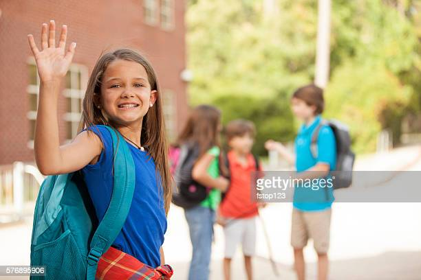 back to school:  elementary-age children, friends on school campus. - first day of school stock pictures, royalty-free photos & images