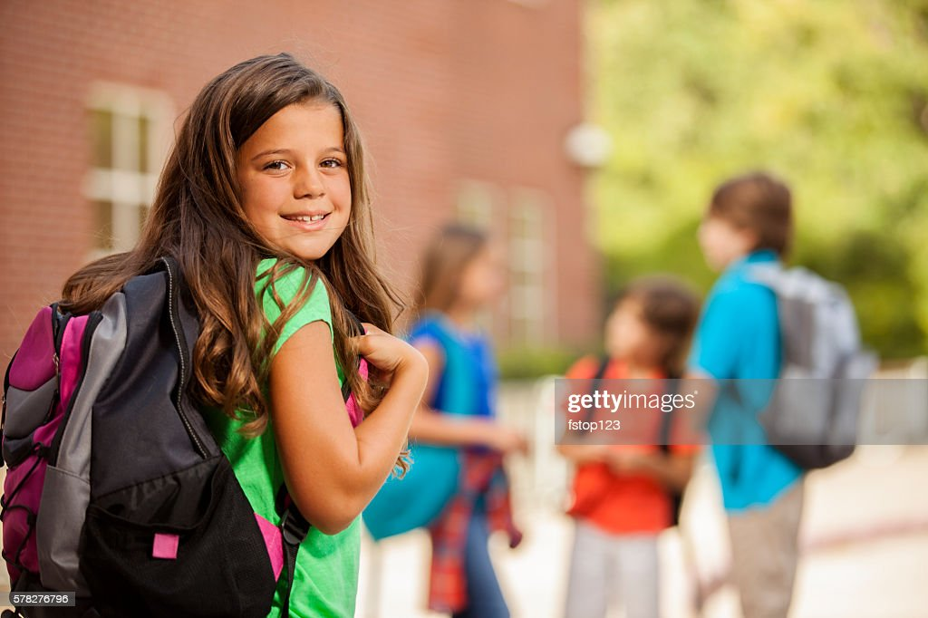 Back to School:  Elementary-age children, girl on school campus. : Stock Photo
