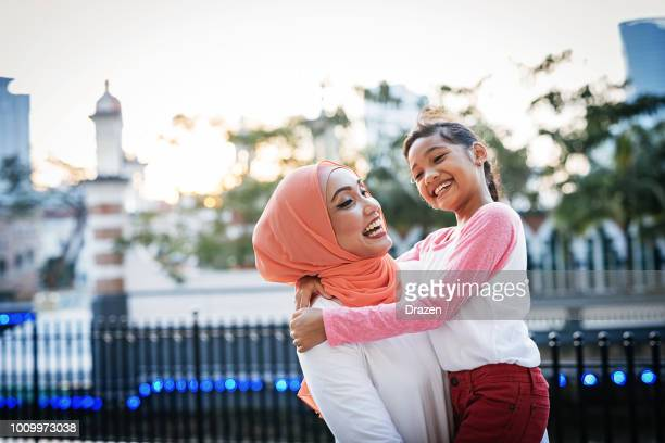 back to school - mother preparing daughter for school and sharing love - islam stock pictures, royalty-free photos & images