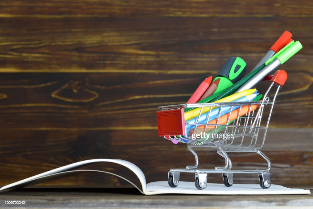 Back to school. School supplies in shopping cart : Stock Photo