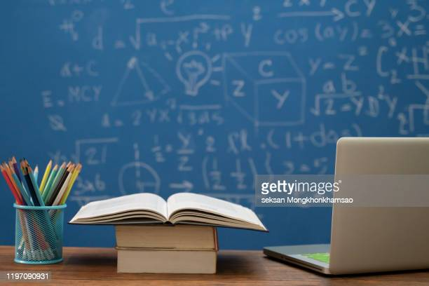 back to school supplies. books and blackboard on wooden background - fully unbuttoned stock pictures, royalty-free photos & images