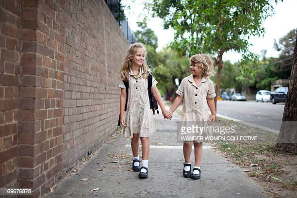 Back to school - two young girls walking to school