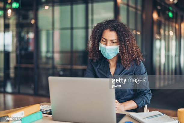 back to work in the office during the pandemic - struggle stock pictures, royalty-free photos & images
