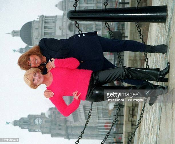 Back together Liver Birds Polly James left and Nerys Hughes with the Liver buildings in the background