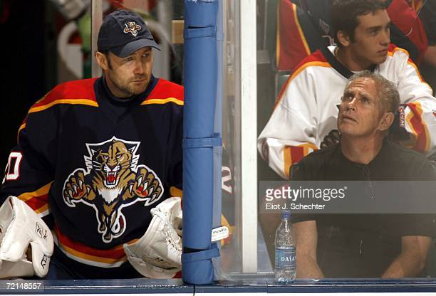 Back up goalie Ed Belfour of the Florida Panthers keeps an eye on the game against the Carolina Hurricanes on October 11 2006 at the Bank Atlantic...