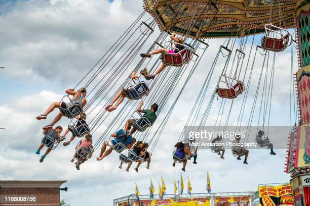 back view chained chair spin ride at wisconsin state fair - festival of remembrance 2019 stock photos and pictures