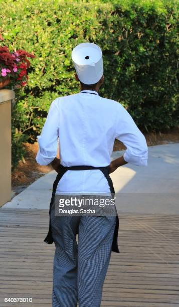 Back view of a Gourmet Chef at an outdoor catering event