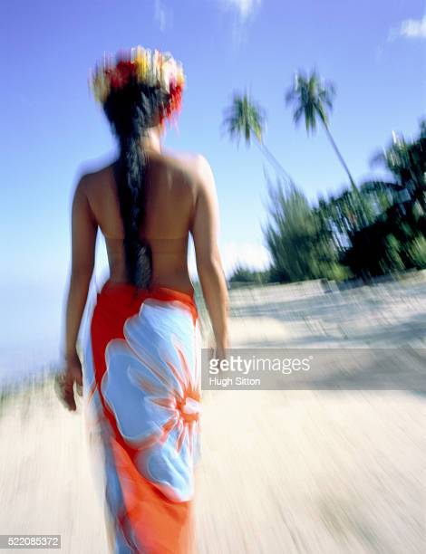 back view of an female inhabitant at the palm-lined beach - hugh sitton stock pictures, royalty-free photos & images