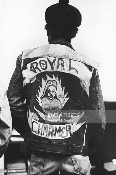 Back view of an unidentified person who wears a handpainted gang jacket that reads 'Royal Charmer' New York November 19 1973