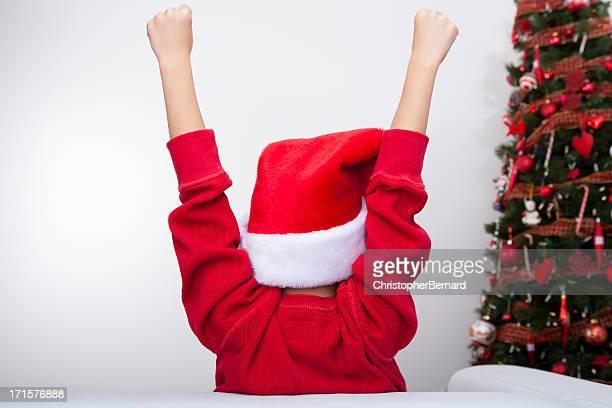 Back view of boy wearing santa's hat
