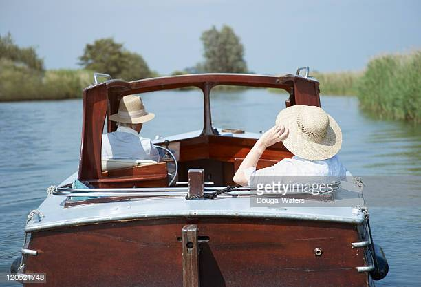 Back view of couple in boat.