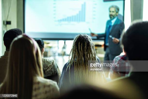 back view of creative people on education event in the office. - attending stock pictures, royalty-free photos & images