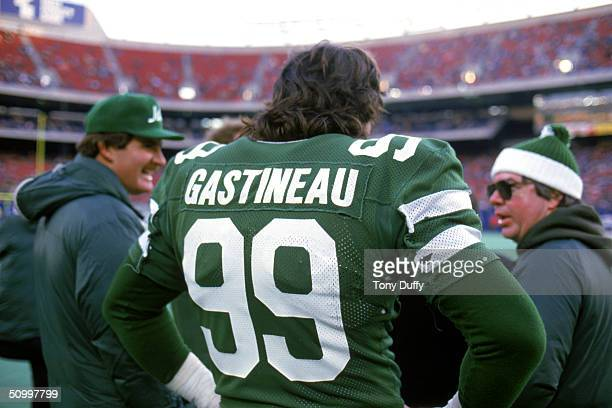 Back view of defensive end Mark Gastineau of the New York Jets as he looks on from the sidelines during a game in 1984