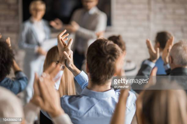 back view of entrepreneurs applauding on a seminar in board room. - applauding stock pictures, royalty-free photos & images