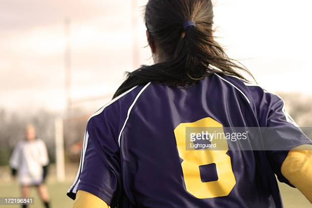 Back view of female soccer player in number 8 jersey