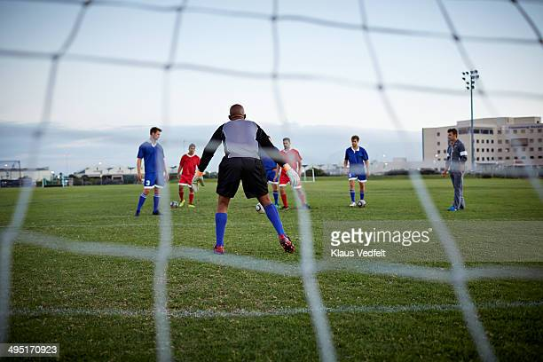 back view of goalkeeper at soccer game - defender soccer player stock photos and pictures