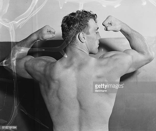 A back view of heavyweight boxer Primo Carnera flexing his muscles on June 19 1933 while preparing for a match with boxer Jack Sharkey