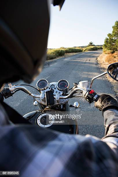 back view of man riding motorbike on open road - handlebar stock photos and pictures