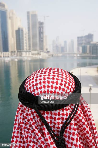 back view of man wearing kaffiyeh - kaffiyeh stock pictures, royalty-free photos & images