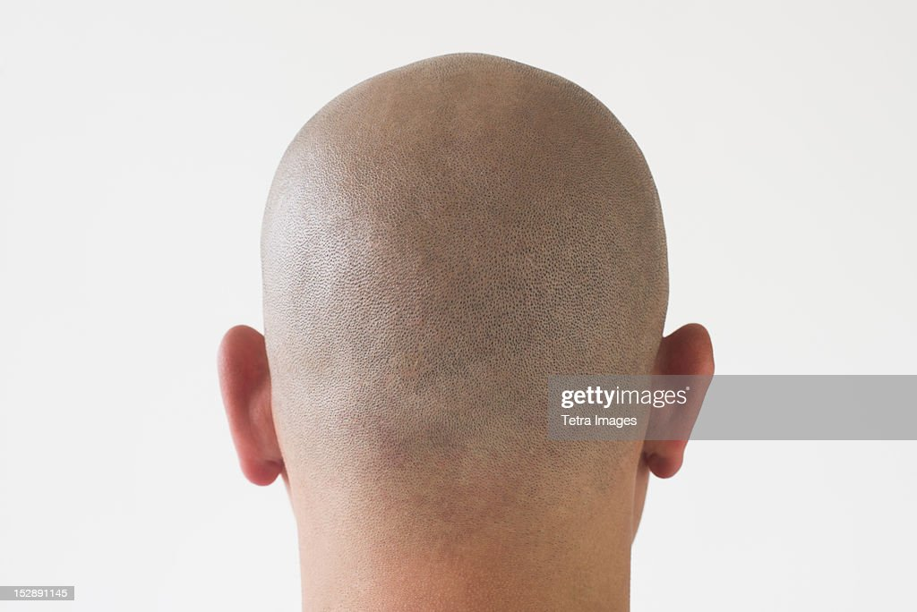 Back view of man with shaved head : Stock Photo