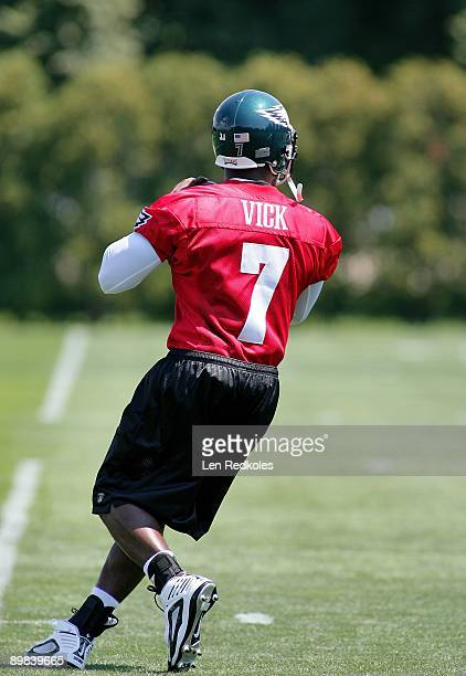 A back view of Michael Vick as he prepares to throw a pass in a workout at the NovaCare Complex on August 15 2009 in Philadelphia Pennsylvania