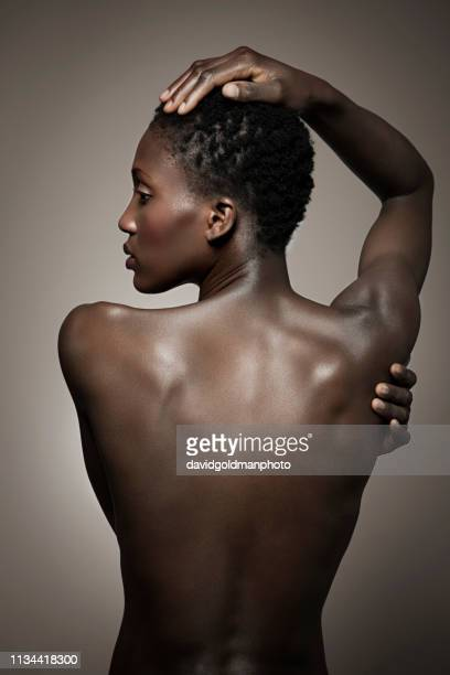 back view of nude woman with hand on head - naket bildbanksfoton och bilder