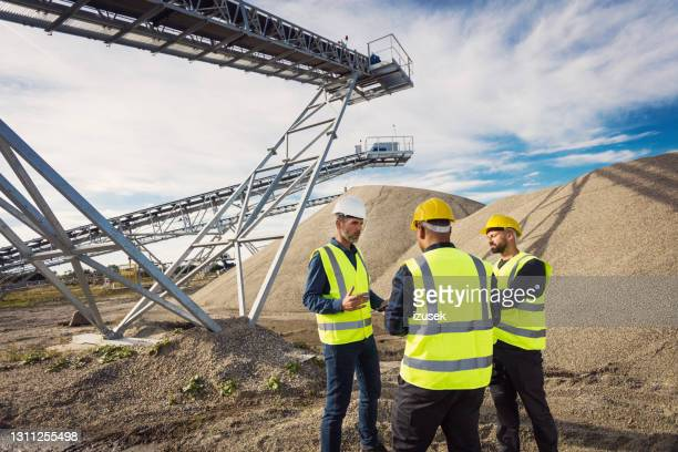 back view of open-pit mine workers - izusek stock pictures, royalty-free photos & images