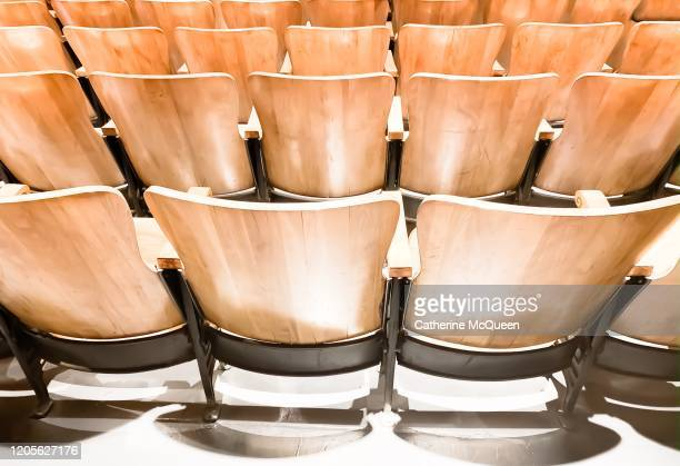 back view of orchestra & theater seating - classical concert stock pictures, royalty-free photos & images