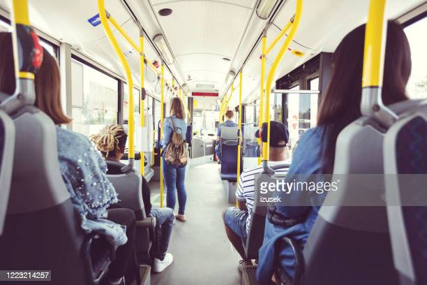 back view of passengers commuting by public transport - person in education stock pictures, royalty-free photos & images