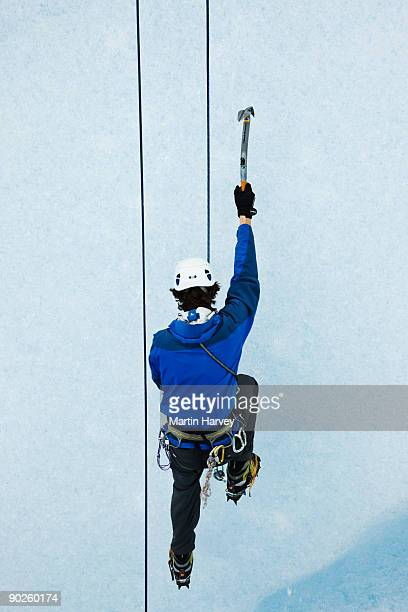 Back view of person climbing mountainside