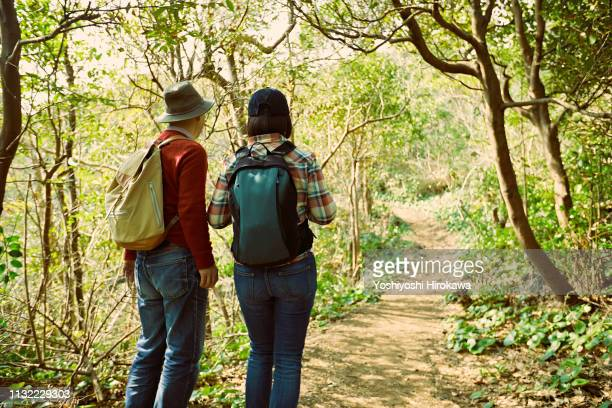 back view of senior couple to enjoy the scenery in promenade on journey. - snapping the ball stock pictures, royalty-free photos & images
